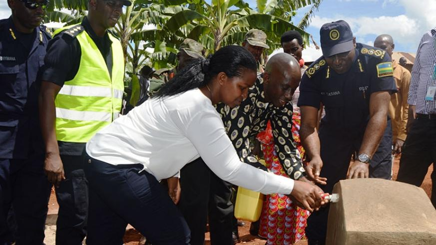 Eastern Province governor Judith Kazayire (L), Kaboneka (C) and Gasana inaugurate clean water source in Kirehe. (Courtesy)