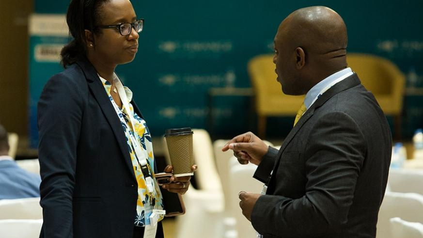 Bank of Kigali CEO, Diane Karusisi (L) chats with Segun Oni, director of Global Travel Wallet, at the second edition of the Dot Finance Africa conference, one of the largest gatherings of financial technology professionals, in Kigali yesterday. (Photos by Timothy Kisambira)