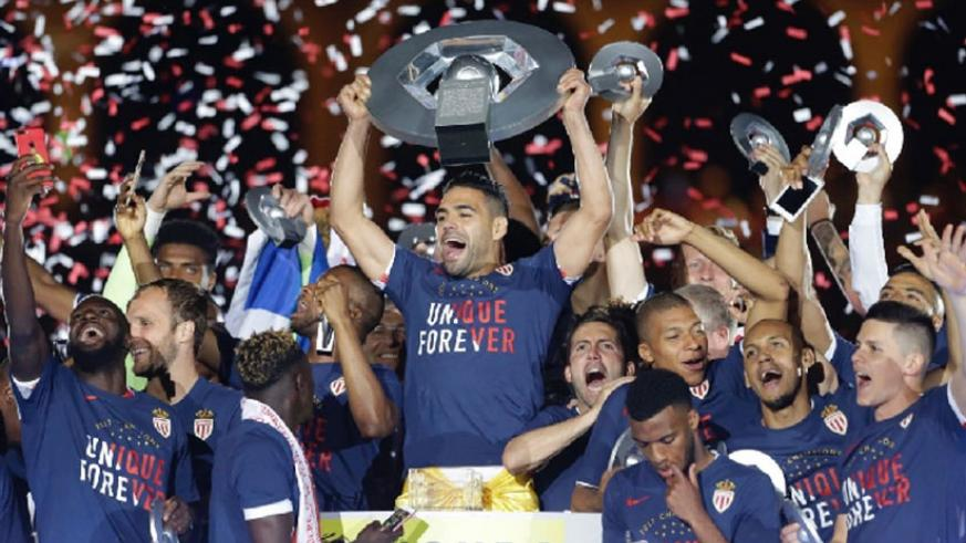 Monaco claim first French title in 17 years · read more. Monaco players hold the trophy as they celebrate their French League One title after beating Saint. Net photo