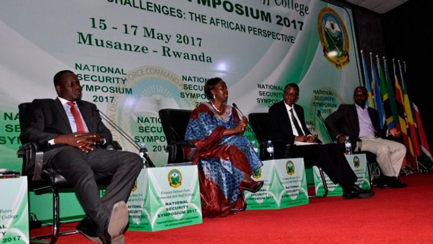 Minister Mushikiwabo, EALA Speaker Kidega and Defence Minister Kabarebe discussing at the Security symposium