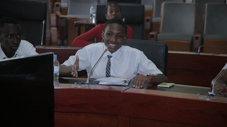 Niyigena, from FAWE Girls School, takes part in the debating competition of Advanced Level category during the event at City Hall yesterday. / Courtesy