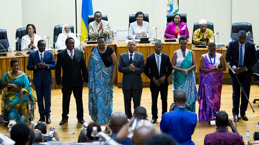 Rwanda's new East African Legislative Assembly representatives before the lawmakers at Parliament after their election yesterday. The regional legislators have pledged to take the region's integration agenda to the next level when they begin their duties next month. / Timothy Kisambira