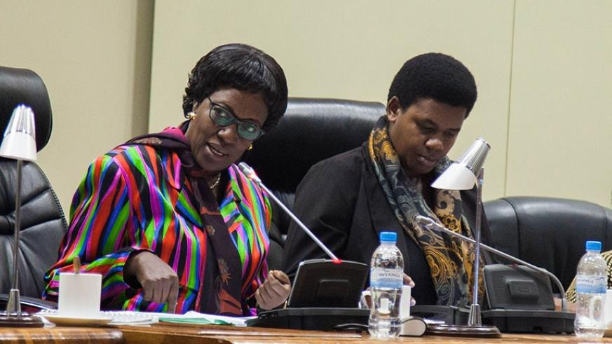 Chairperson of budget and national patrimony committee Mukayuhi  Rwaka  Constance speaks as Deputy Chairperson  of the committee MUKARUGWIZA Annonciata listens during a session in Parliament. Nadege I