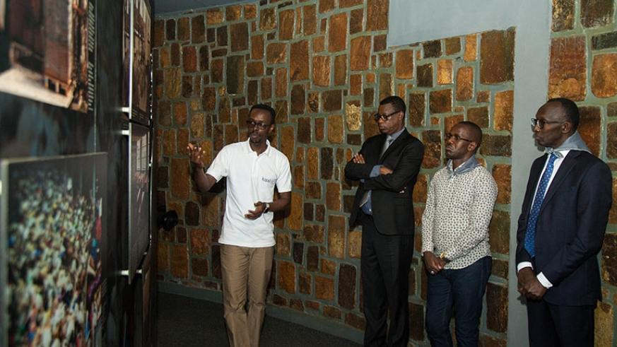 Defence minister James Kabarebe, State Minister for Constitutional and Legal Affairs Evode Uwizeyimana (second right) and Chief Justice Sam Rugege (right) on a guided tour of Kigali Genocide memorial on Friday. The Chief Justice said more Rwandans were now willing to testify against suspects of hate crimes, resulting in a significant increase of convictions. Nadege Imbabazi