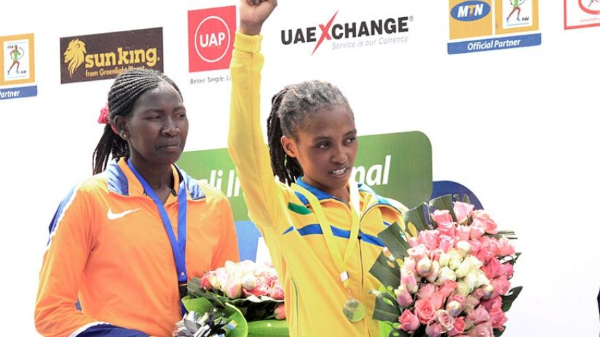 Salome Nyirarukundo  celebrates on the podium. The 20-year old beat Sheilla Chesang from Kenya to win Gold in the Women's half marathon yesterday. S. Ngendahimana