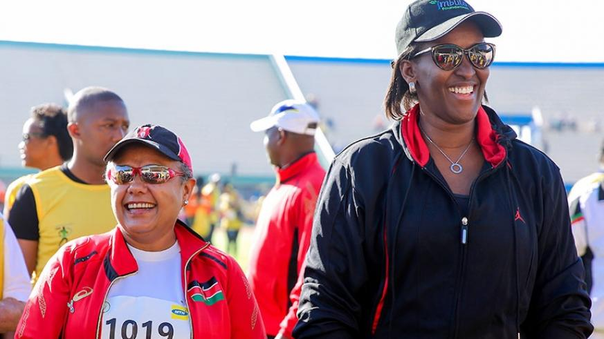 First Lady Jeannette Kagame and her Kenyan counterpart Mrs Margaret Kenyatta at the start of the 2017 Kigali International Peace Marathon yesterday. Rwanda's Salome Nyirarukundo made history after becoming the first Rwandan woman to win the half marathon since inception of the event in 2005.