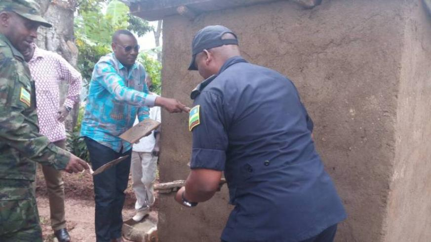 State Minister in charge of Primary and Secondary Education, Isaac Munyakazi, DIGP Juvenal Marizamunda joined by Nyaruguru residents to construct one of the 36 toilets.