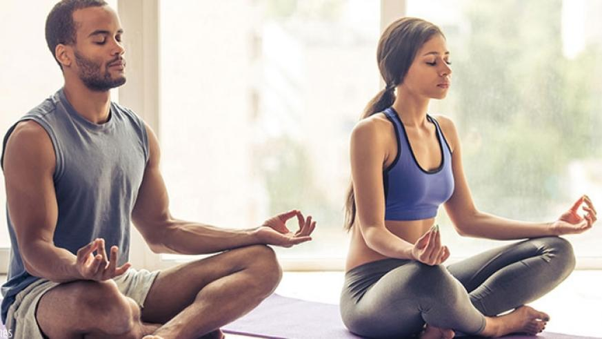 A couple meditating for stress relief. / Net photo.