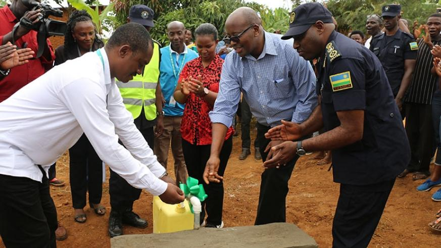 Minister James Musoni inagurating a water source in Gatare Village. (Photos by Kelly Rwamapera)