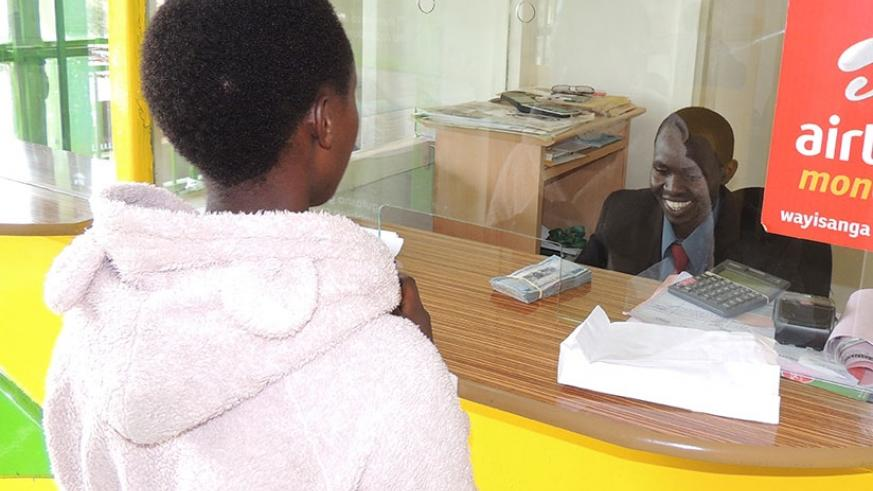 A customer being served at CIC, a Kicukiro-based microfinance institution.  (File)