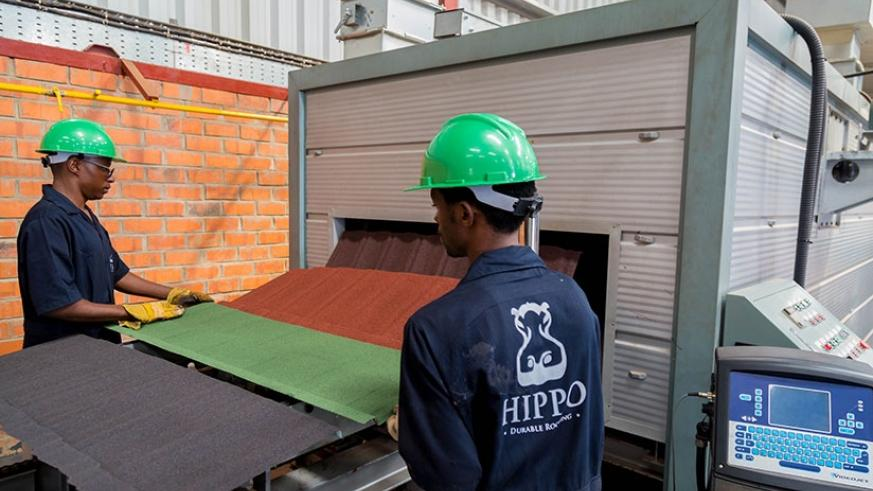Employees of Hippo, a local firm that makes roofing materials. (File)