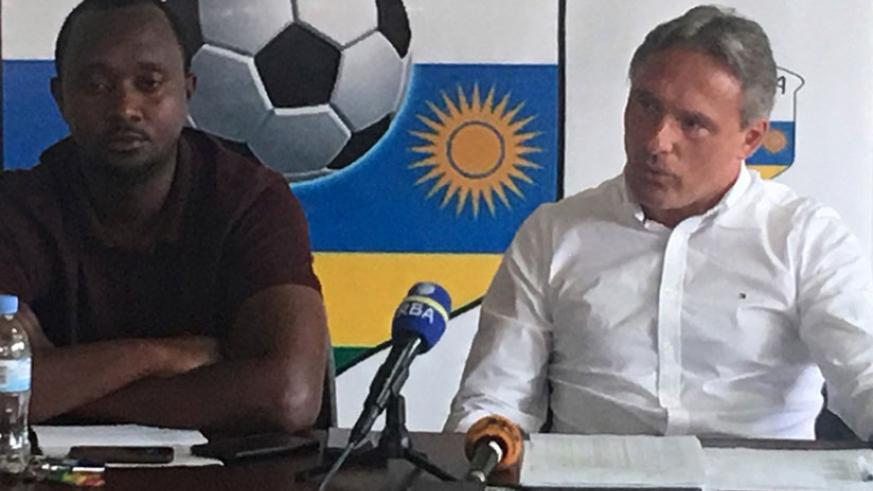 Amavubi head coach Antoine Hey (right) and assistant coach Vincent Mashami (left) at a press briefing at FERWAFA headquarters on Thursday. (courtesy)