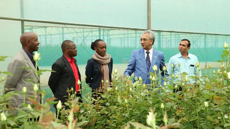 UK Prime Minister's Trade Envoy to Rwanda, Lord Dolar Popat (second right) and NAEB officials at Gishari Flower Park, Rwamagana District in March. (Courtesy)