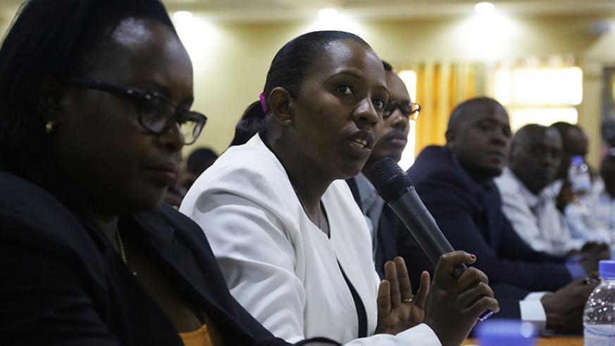 The Permanent Secretary at the Local Government and Social Affairs, Odette Uwamariya, addresses participants at a high-level policy dialogue in Kigali yesterday. Experts at the meeting urged government to actively involve citizens in the formulation of the 3rd Economic Development and Poverty Reduction Strategy. / Sam Ngendahimana