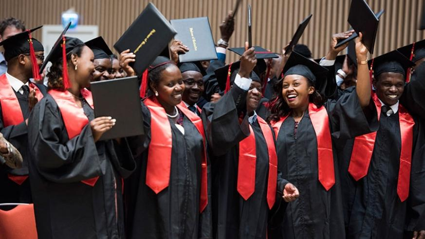 Graduates of  University of Global Health and Equity celebrate after receiving their degrees yesterday. Village Urugwiro.