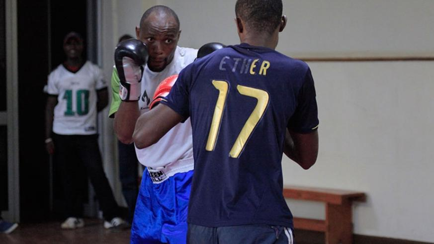 Vincent Nsengiyumva in training with national team coach Jean Claude Gatorana in preparation for the African Boxing Championships. S. Ngendahimana