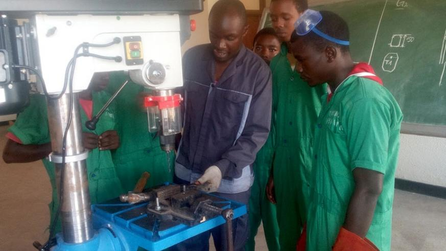 Yves Lambert Kwizera (right) with fellow students in a practical lesson at Kavumu Traning Centre in Nyanza District. (Photos by Remy Niyingize)