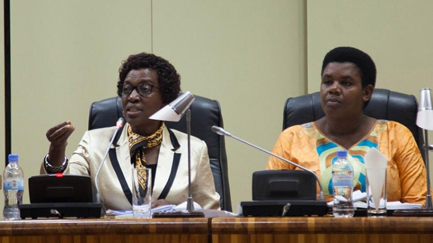 MP Rwaka (L) speaks during the plenary session in Parliament as deputy chairperson of the committee Annonciata Mukarugwiza looks on. (Nadege Imbabazi)