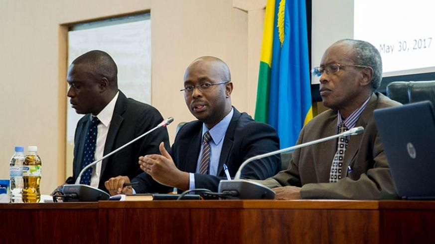 Murangwa presents results on current status of labour as Senator Laurent Nkusi (R) and Deputy Ombudsman Clement Mukeshabatware look on. (Photos by Faustin Niyigena)