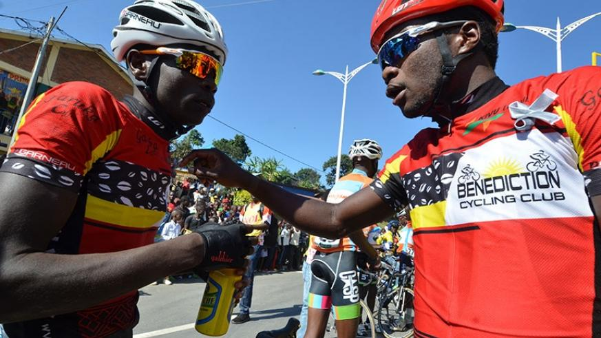 Uwizeyimana (right) chats with Club Benediction teammate Jean Bosco Nsengimana after winning the Race to Remember last weekend. (Sam Ngendahimana)