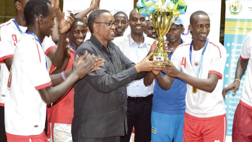 INATEK Vice Chancellor Prof. Silas Lwakabamba lifts the Genocide Memorial Volleyball tournament trophy last year. / File