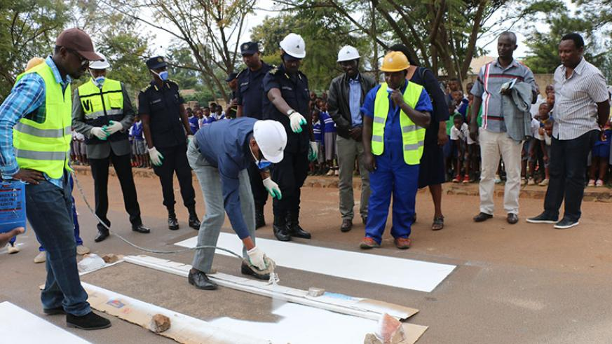 City of Kigali vice mayor in charge of economic development, Parfait Busabizwa, painting a zebra crossing at the official launch. / Courtesy