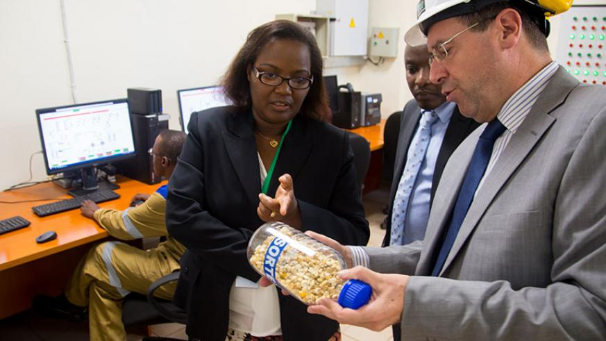 Africa Improved Foods' chief operations officer Jan Vriens explains to Minister Mukeshimana about their products. / Faustin Niyigena