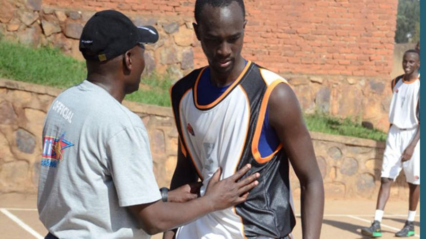 APR captain Parfait Ishimwe, right, listens to coach Cliff Owuor during a league game against 30-Plus last season. File photo