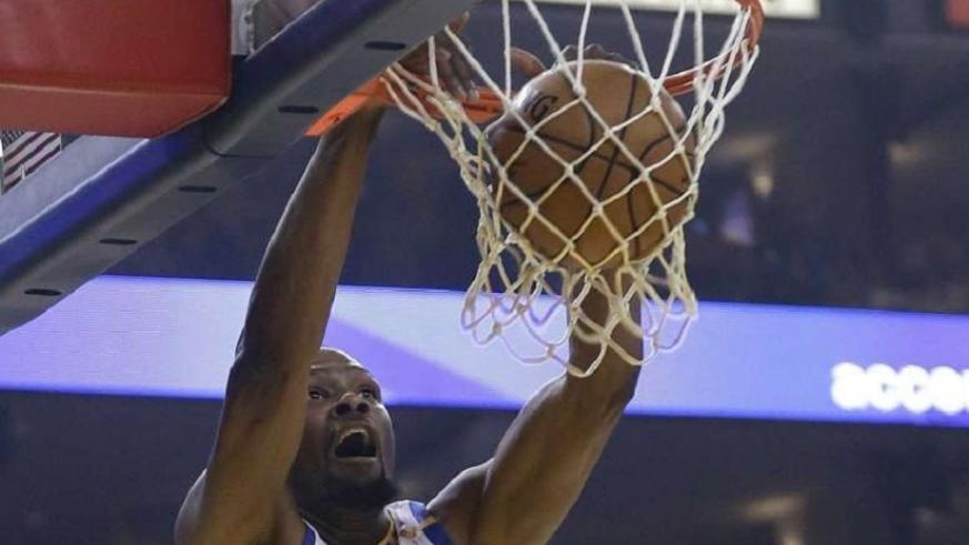 Golden State Warriors forward Kevin Durant (35) dunks against the Cleveland Cavaliers. Net photo