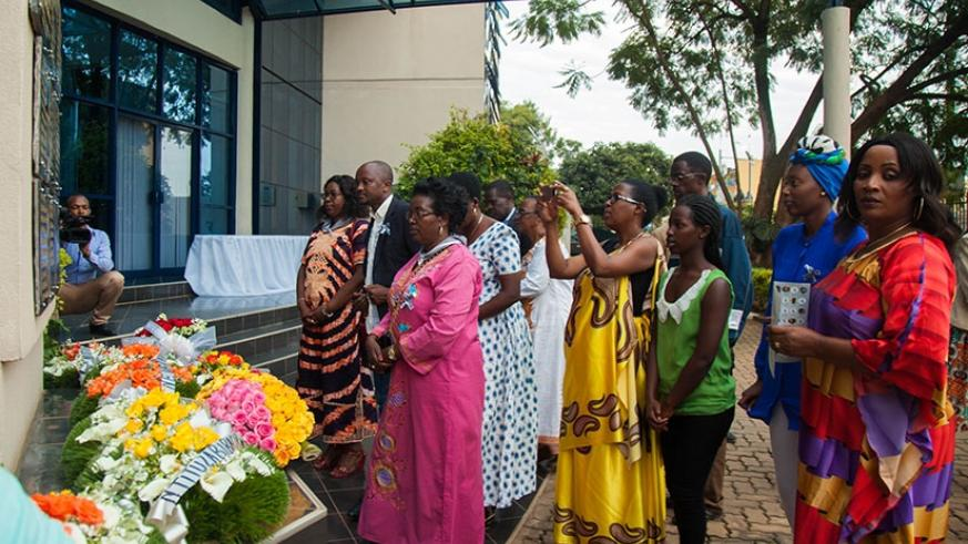 Families and friends lay wealth at the memorial of Ministry of Finance during the commemoration event on Friday. Nadege Imbabazi.