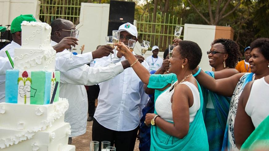PSD President Vincent Biruta (C) and other party officials in a toast to celebrate PSD's 25th anniversary on Saturday. At the same event, the party endorsed President Kagame as the rightful candidate in the forthcoming presidential elections. Nadege Imbabazi.