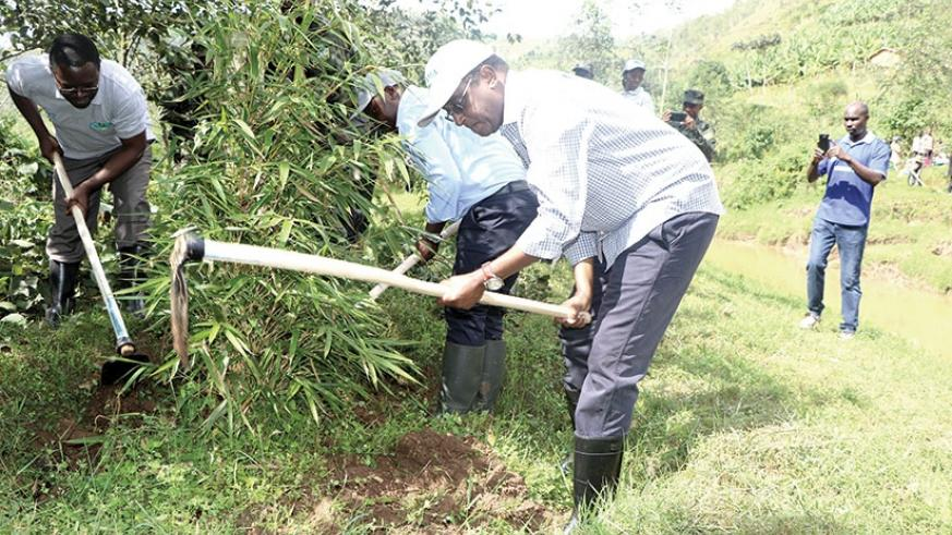 Minister Biruta during Umuganda as part of World Environment Day in Gakenke district. The minister called for concerted efforts to protect environment. J d'Amour Mbonyinshuti