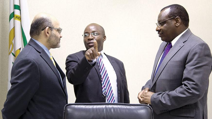 State Minister for Transport Alex Nzahabwanimana (C) chats with World Bank country manager Yasser El-Gammal (L) and Finance and Economic Planning minister Claver Gatete. The Government and the World Bank Group have signed a financing agreement worth Rwf71 billion for rehabilitation of the road linking Ngoma and Nyanza districts. Timothy Kisambira.