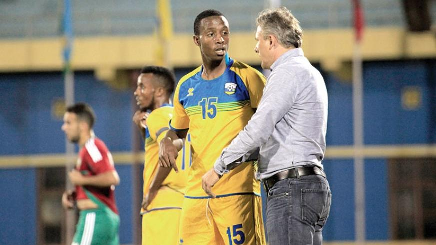 Hey gives instructions to defender Emery Bayisenge during the second half of the first game against Morocco on Friday. The coach has nemed a 19-player squad for next week's Afcon 2019 qualifier.