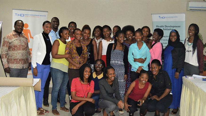 Participants in the workshop on HIV pose for a group photo after the event. (Francis Byaruhanga)