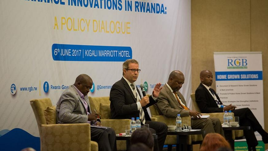 Panelists L-R; Egide Rugamba, secretary-general of Rwanda Association of Local Government Authorities; Dr Stephan Klingebiel, from German Development Institute; Wellars Gasamagera, director-general of Rwanda Management Institute; and Richard Mushabe, division manager at Finance and Economic Planning ministry at a policy dialogue on governance held in Kigali yesterday.  (Photos by Timothy Kisambira)