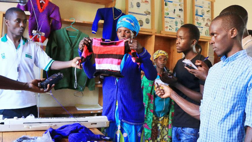 Beatrice Mukabutera, a member of the group, displays some of the products the women make. (Photos by Hudson Kuteesa)