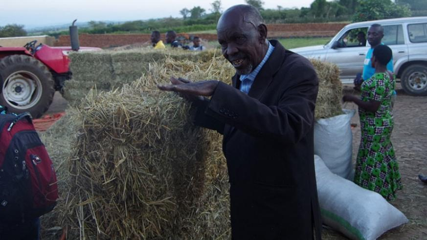 Karani showing some of his grass bales.  (Courtesy)