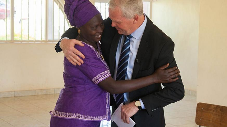 Hjalmarsson hugs Nyiramisago as he handed her a reparation package in Kigali yesterday. (Nadege Imbabazi)
