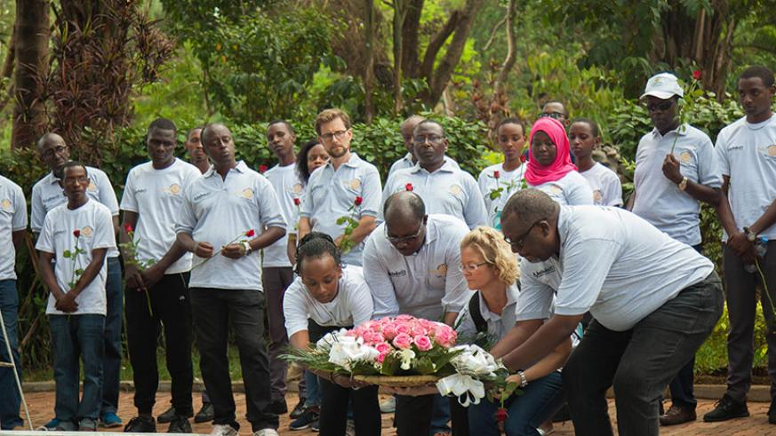 Rotarians lay a wreath at Kigali Genocide Memorial  yesterday. Nadege I