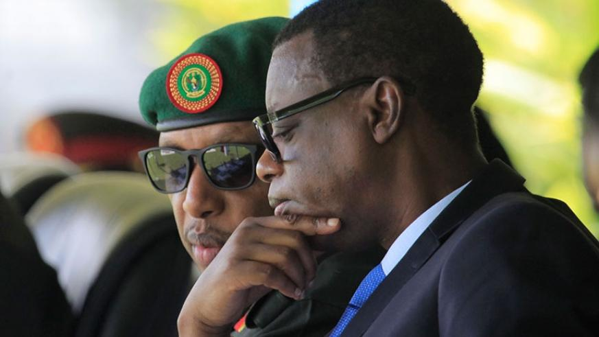 Defence Minister James Kabarebe (R) consults with RDF Chief of Defence Staff Gen Patrick Nyamvumba during the graduation ceremony in Musanze District, yesterday. Sam Ngendahimana.