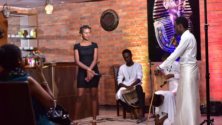 Ikome mix poetry, dance and instruments on stage. / Courtesy