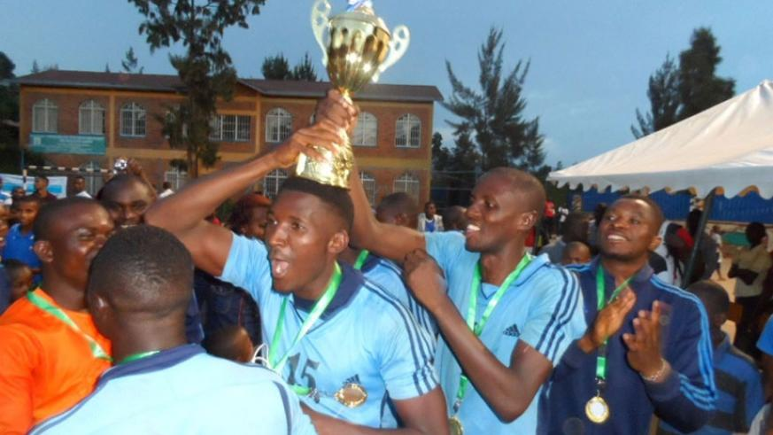 Police players celebrate after retaining the Genocide memorial tournament title. Courtesy.