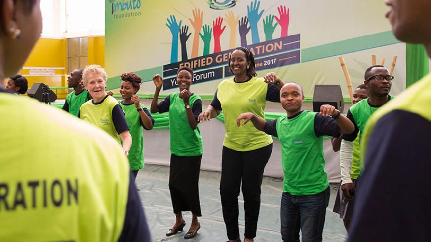 First Lady Jeannette Kagame dances with the youth during the Edified Generation Youth Forum. / Courtesy