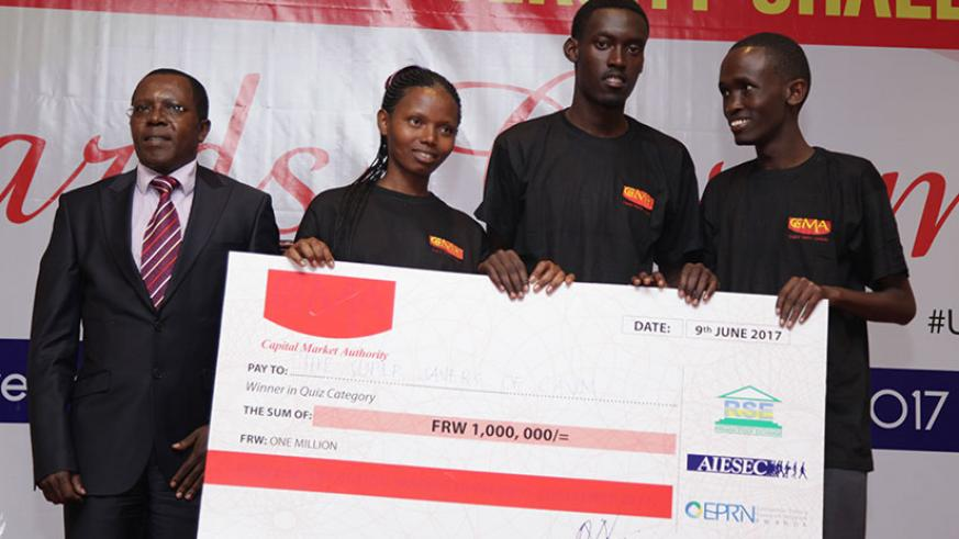Robert Mathu, CMA executive director (L), with students from CAVM during the award ceremony. / Appolonia Uwanziga