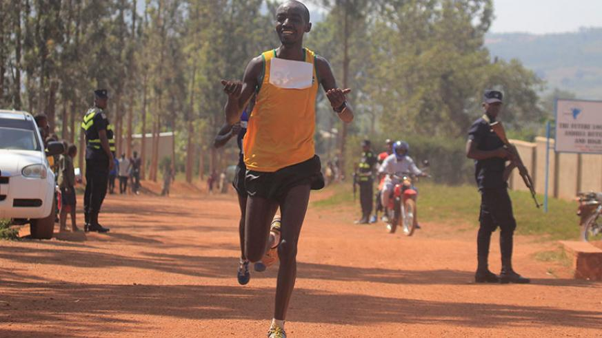 APR Athletics Club runner Alexis Nizeyimana celebrates his victory in the Bugesera 20 km race on Sunday in Nyamata. (All photos by Sam Ngendahimana)