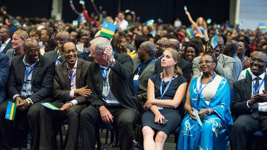 Participants share a light moment during Rwanda Day event in Gent, Belgium on Saturday. Rwandans and friends of Rwanda turned up in large numbers for the event. / Village Urugwiro