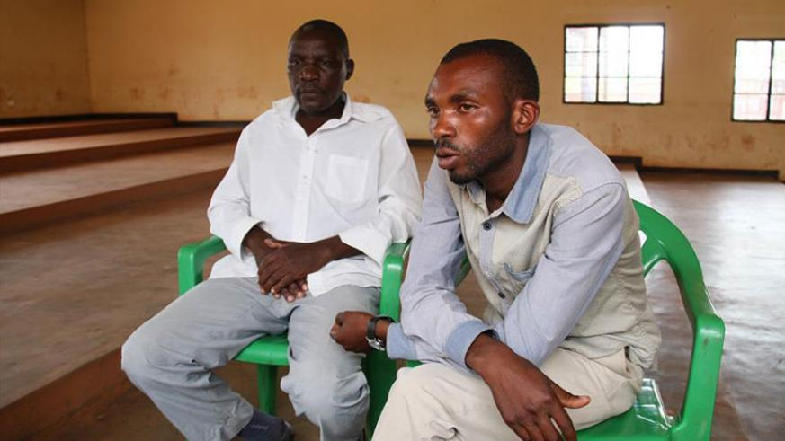 Rwamirindi (R) and Jean Marie Vianney Mudaheranwa during the interview in Kabarondo, Eastern Province, last week. / Xinhua