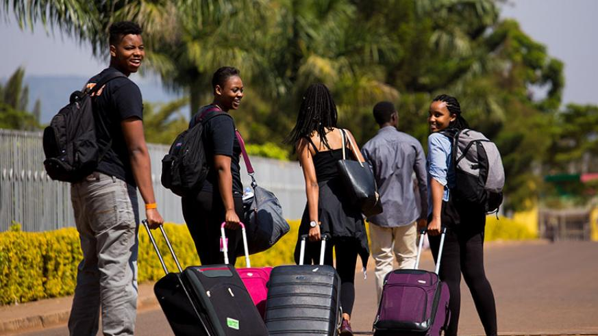 Some of the youths roll their luggage to an assembly point ahead of their departure to Gabiro. / Timothy Kisambira