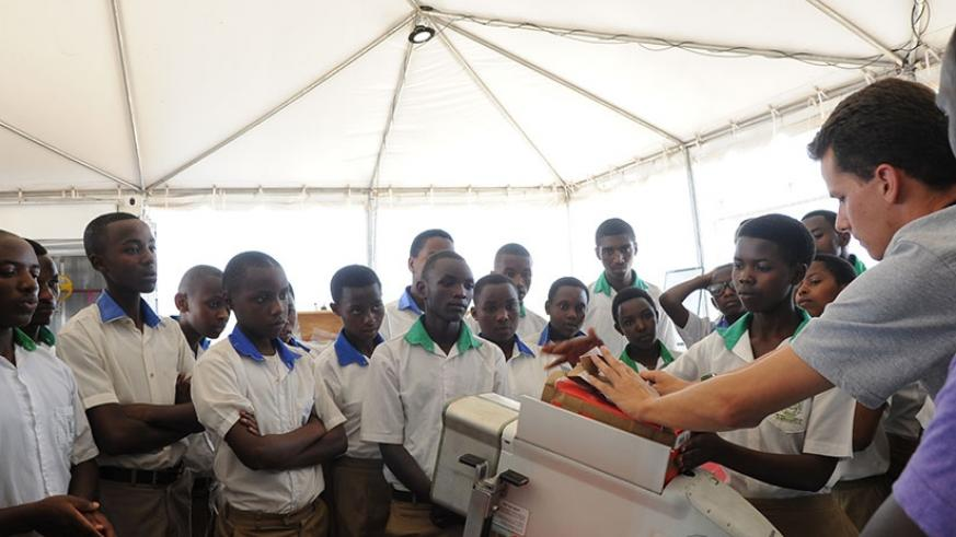 Students learn about how technology works at the Zipline centre in Muhanga District.  (Photos by Dennis Agaba)